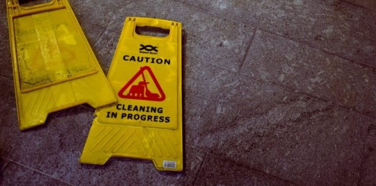 Two wet floor signs on the ground
